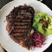 Grilled rib-eye with stuffed cabbage and red onion confit