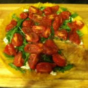 Polenta tart with goat cheese, arugula and roasted Campari tomatoes