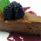 Dark chocolate-espresso cheesecake with triple berry-beet coulis