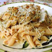Grilled Chicken over Tomato Alfredo Sauce