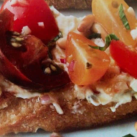 Three Tomato Crostini with Two Cheeses