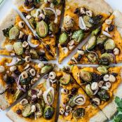 Butternut Squash Pizza with Glazed Brussels Sprouts Hazelnuts & Dates