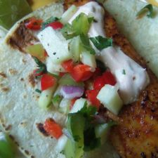 Blackened Tilapia Tacos Topped With Chayote-Tomatillo Salsa & Light Chipotle Crema
