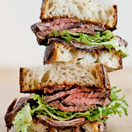 Hanger Steak & Bacon Sandwich With Frisée & Red Onion Jam