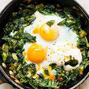 Skillet Baked Eggs with Spinach, Yogurt, and Chili Oil