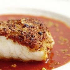 Pistachio-Crusted Sea Bass with Tomato Curry Broth