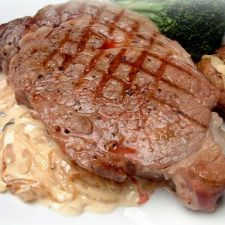 Grilled Ribeye Steak with Onion Blue Cheese Sauce from The Pioneer Woman Cooks