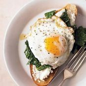 Kale, Lemon, & Ricotta Bruschetta topped with a Fried Egg