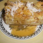 Pina colada white bread pudding with coconut topping/rum caramel sauce