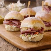 Corned Beef Sliders on Potato Rolls with Cabbage Slaw and Guinness Mustard