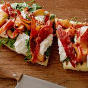 Grilled Summer Pizzette with Caramelized Peaches, Burrata, Arugula & Crispy Serrano